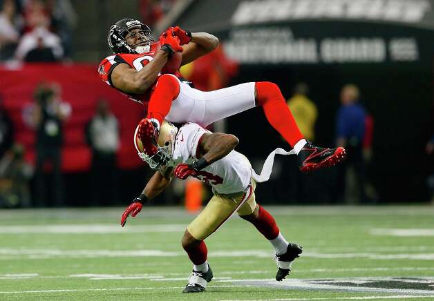Wide receiver Roddy White #84 of the Atlanta Falcons catches a pass as he is hit by free safety Dashon Goldson #38 of the San Francisco 49ers in the first quarter in the NFC Championship game at the Georgia Dome on January 20, 2013 in Atlanta, Georgia. Photo: Kevin C. Cox, Getty Images / 2013 Getty Images