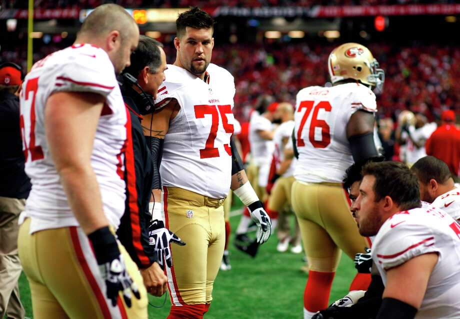 San Francisco 49ers Offensive tackle Alex Boone (75) talks with teammates before the San Francisco 49ers game against the Atlanta Falcons in the NFC Championship game at the Georgia Dome in Atlanta, GA., on Sunday January 20, 2013. Photo: Luanne Dietz, The Chronicle / ONLINE_YES