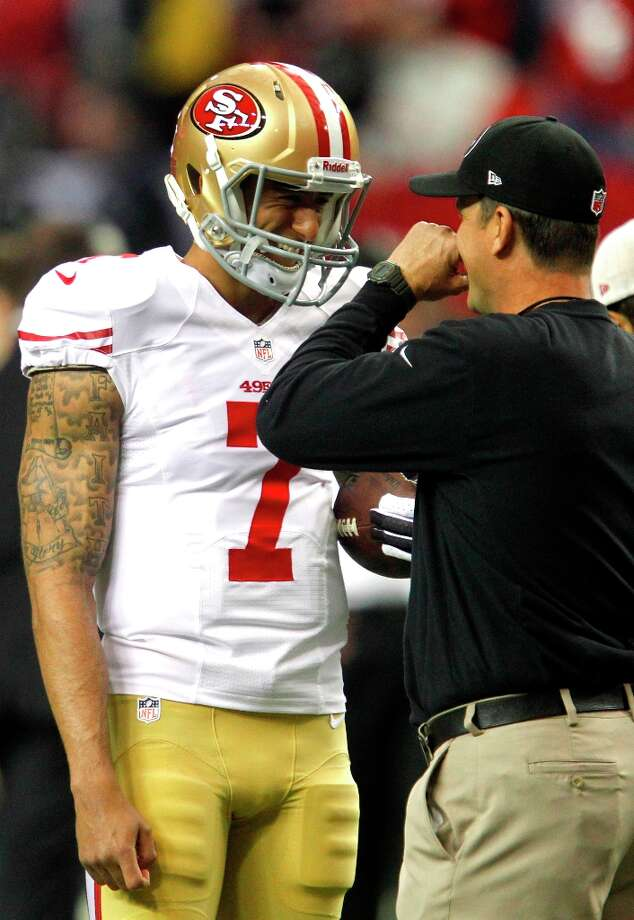 San Francisco 49ers Quarterback Colin Kaepernick (7) laughs with coach Jim Harbaugh before the San Francisco 49ers game against the Atlanta Falcons in the NFC Championship game at the Georgia Dome in Atlanta, GA., on Sunday January 20, 2013. Photo: Brant Ward, The Chronicle / ONLINE_YES
