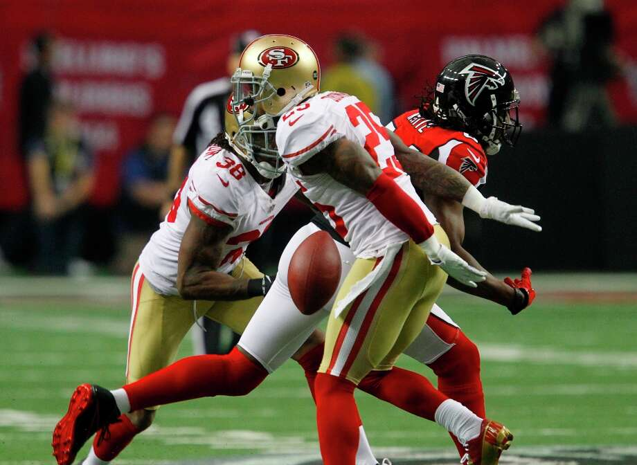 Cornerback Chris Culliver (29) and Safety Dashon Goldson (38) break up a pass in the first quarter of the San Francisco 49ers game against the Atlanta Falcons in the NFC Championship game at the Georgia Dome in Atlanta, GA., on Sunday January 20, 2013. Photo: Brant Ward, The Chronicle / ONLINE_YES