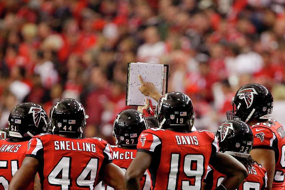 The Atlanta Falcons  look at the playbook during the first half of the NFL football NFC Championship game against the San Francisco 49ers Sunday, Jan. 20, 2013, in Atlanta. Photo: Mark Humphrey, Associated Press / AP