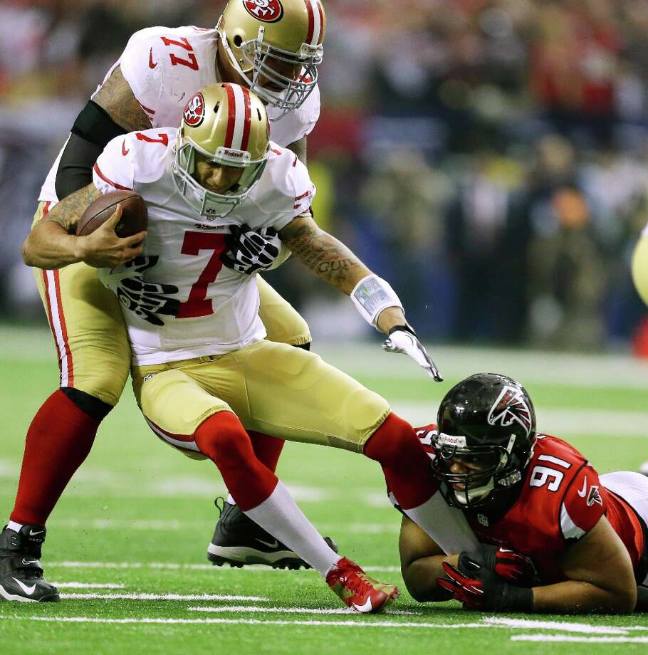 Atlanta Falcons' Corey Peters (91) sacks San Francisco 49ers' Colin Kaepernick (7) during the first half of the NFL football NFC Championship game Sunday, Jan. 20, 2013, in Atlanta. Trying to hold up Kaepernick is 49ers' Mike Iupati. Photo: David Goldman, Associated Press / AP
