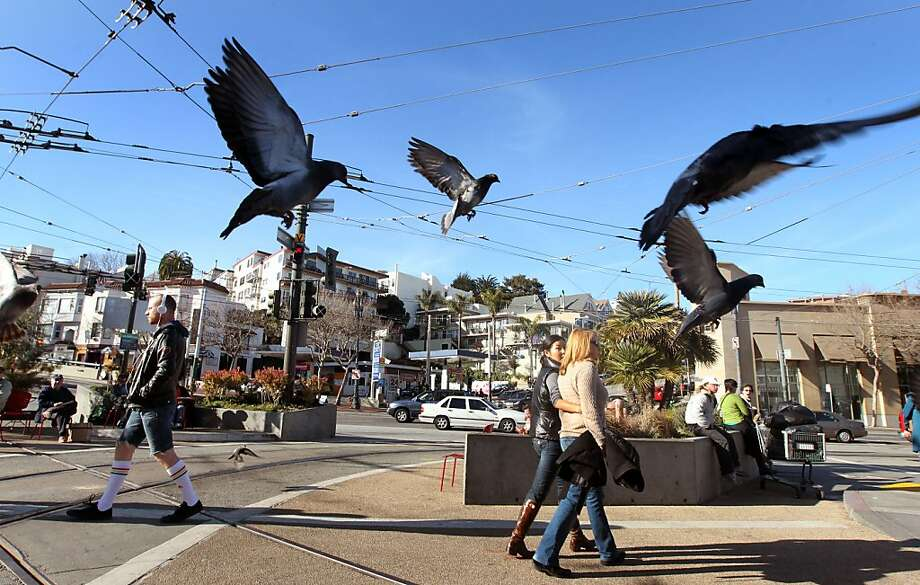 Pedestrians and pigeons share sidewalk space at Castro and Market. The makeover will enhance the district's streetscapes. Photo: Lance Iversen, The Chronicle