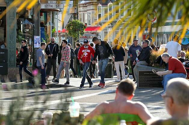 Pedestrians stroll up Castro to Market Street on a sunny Saturday. Money has just been allocated for the long-awaited makeover. Photo: Lance Iversen, The Chronicle