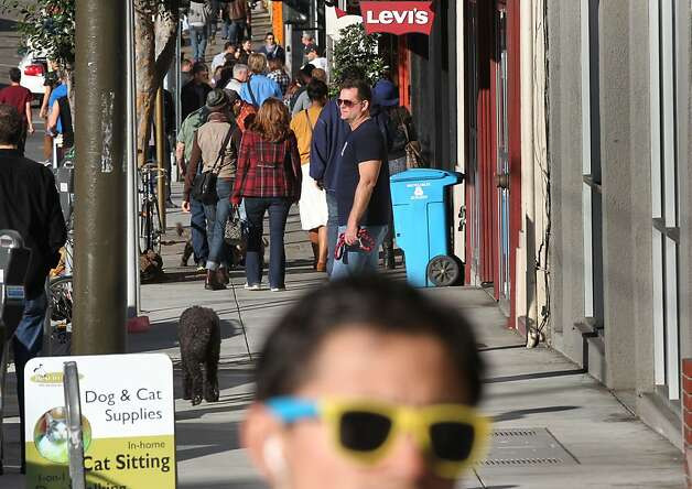 The city of San Francisco has a plan to widen sidewalks and make other improvements to Castro Street between Market and 19th streets. Pedestrians are so crowded they are often forced to step onto the busy Castro Street Saturday Jan 19, 1013, in San Francisco California. Photo: Lance Iversen, The Chronicle