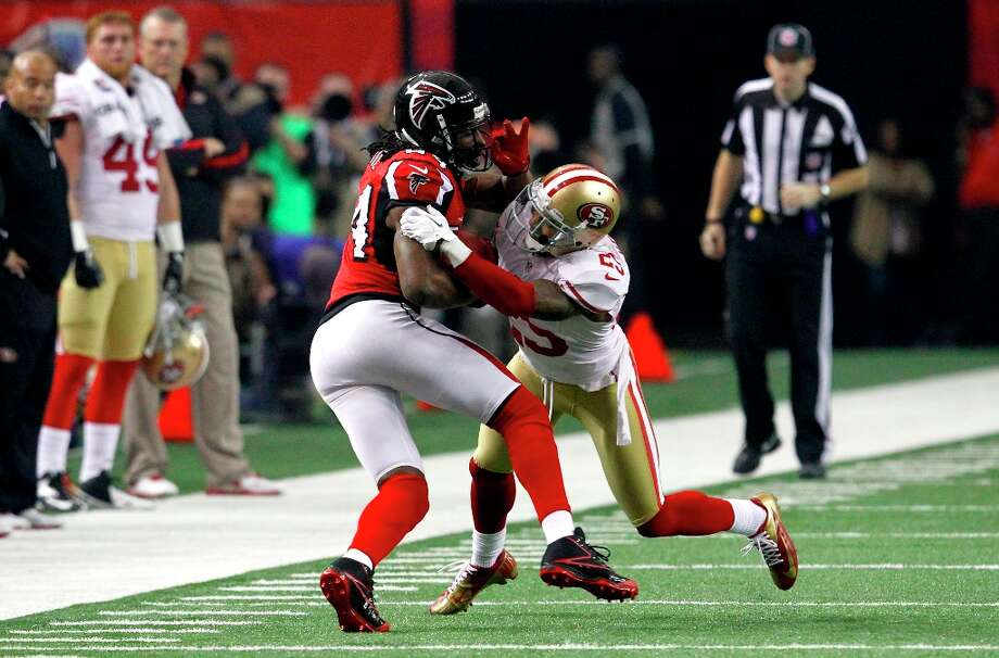 Cornerback Tarell Brown (25) takes down Atlanta Falcons running back Jason Snelling (44) in the second quarter of the San Francisco 49ers game against the Atlanta Falcons in the NFC Championship game at the Georgia Dome in Atlanta, GA., on Sunday January 20, 2013. Photo: Brant Ward, The Chronicle / San Francisco Chronicle