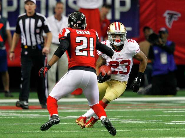 San Francisco 49ers Running back LaMichael James (23) runs pass Atlanta Falcons cornerback Chris Owens (21) during the second quarter of the San Francisco 49ers game against the Atlanta Falcons in the NFC Championship game at the Georgia Dome in Atlanta, GA., on Sunday January 20, 2013. Photo: Brant Ward, The Chronicle / San Francisco Chronicle