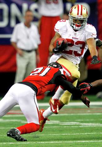 Running back LaMichael James (23) runs past Atlanta Falcons cornerback Chris Owens (21) and running back Jason Snelling (44) int he second quarter of the San Francisco 49ers game against the Atlanta Falcons in the NFC Championship game at the Georgia Dome in Atlanta, GA., on Sunday January 20, 2013. Photo: Brant Ward, The Chronicle / San Francisco Chronicle