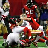 Quarterback Colin Kaepernick (7) is sacked during the fist half of the San Francisco 49ers game against the Atlanta Falcons in the NFC Championship game at the Georgia Dome in Atlanta, GA., on Sunday January 20, 2013.