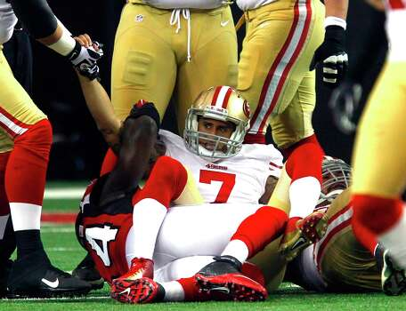 Quarterback Colin Kaepernick (7) is sacked in the first quarter of the San Francisco 49ers game against the Atlanta Falcons in the NFC Championship game at the Georgia Dome in Atlanta, GA., on Sunday January 20, 2013. Photo: Brant Ward, The Chronicle / San Francisco Chronicle
