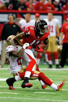 San Francisco 49ers Cornerback Tarell Brown (25) attempts to stop Atlanta Falcons wide receiver Julio Jones (11) during the first quarter of the San Francisco 49ers game against the Atlanta Falcons in the NFC Championship game at the Georgia Dome in Atlanta, GA., on Sunday January 20, 2013. Photo: Carlos Avila Gonzalez, The Chronicle / ONLINE_YES