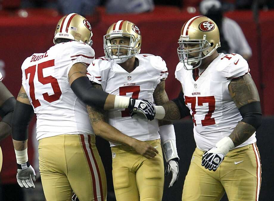Offensive tackle Alex Boone (75) and Offensive guard Mike Iupati (77) help Quarterback Colin Kaepernick (7) up after a sack int he first half of the San Francisco 49ers game against the Atlanta Falcons in the NFC Championship game at the Georgia Dome in Atlanta, GA., on Sunday January 20, 2013. Photo: Brant Ward, The Chronicle