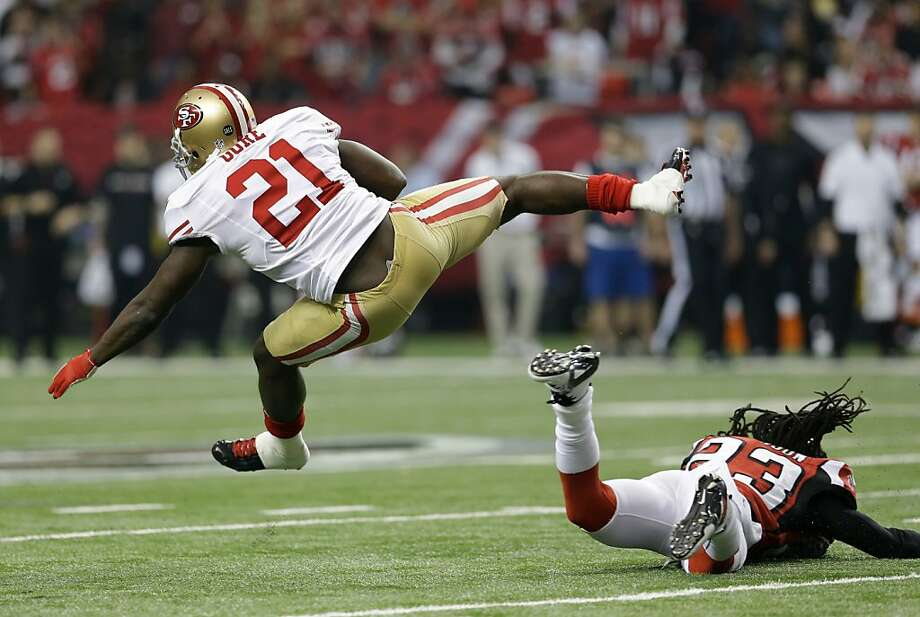 San Francisco 49ers' Frank Gore gets past Atlanta Falcons' Dunta Robinson (23) for a first down during the first half of the NFL football NFC Championship game Sunday, Jan. 20, 2013, in Atlanta. (AP Photo/Mark Humphrey) Photo: Mark Humphrey, Associated Press