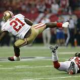 San Francisco 49ers' Frank Gore gets past Atlanta Falcons' Dunta Robinson (23) for a first down during the first half of the NFL football NFC Championship game Sunday, Jan. 20, 2013, in Atlanta. (AP Photo/Mark Humphrey)