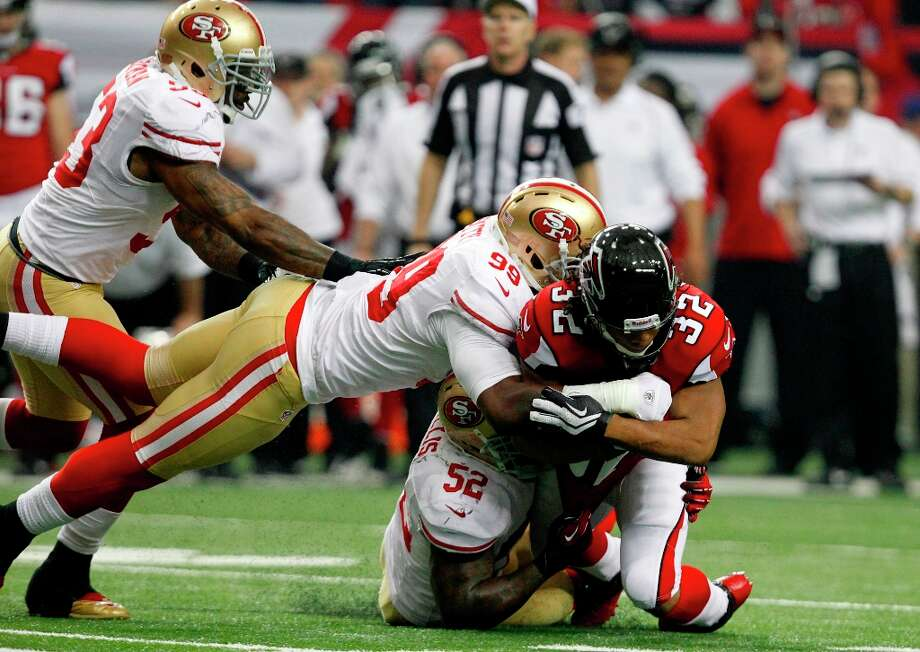 Atlanta Falcons running back Jacquizz Rodgers (32) is brought down by San Francisco 49ers Linebacker Aldon Smith (99) and Linebacker Patrick Willis (52) during the first half of the the San Francisco 49ers game against the Atlanta Falcons in the NFC Championship game at the Georgia Dome in Atlanta, GA., on Sunday January 20, 2013. Photo: Michael Macor, The Chronicle / ONLINE_YES