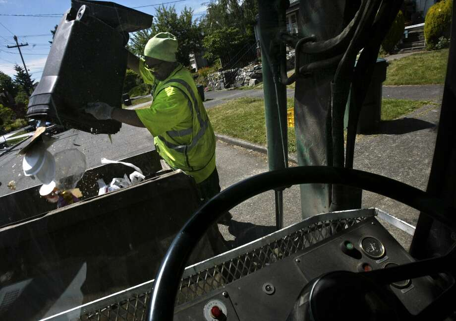 OPEN: Trash and recycling services in Seattle and King County Garbage men keep working for you, baby. (seattlepi.com file)