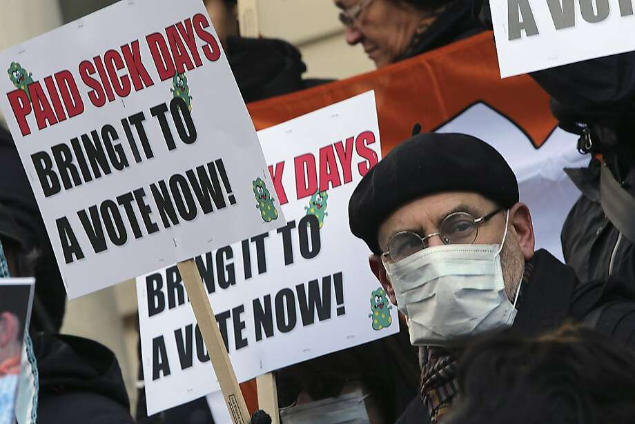 Activists rally Friday at New York City Hall for action on legislation providing paid sick days. Photo: Mary Altaffer, Associated Press