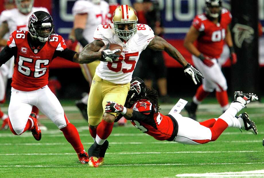 San Francisco 49ers Tight end Vernon Davis (85) runs through an attempted tackle in the first half of the San Francisco 49ers game against the Atlanta Falcons in the NFC Championship game at the Georgia Dome in Atlanta, GA., on Sunday January 20, 2013. Photo: Brant Ward, The Chronicle / ONLINE_YES