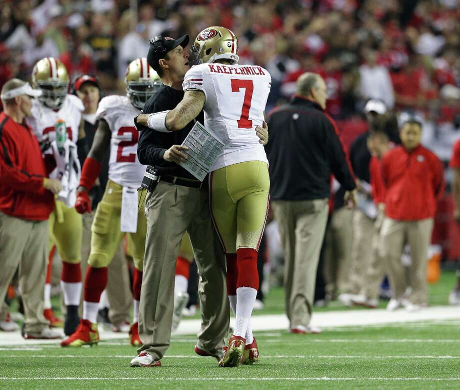 San Francisco 49ers head coach Jim Harbaugh celebrates with Colin Kaepernick (7) after a touchdown during the second half of the NFL football NFC Championship game against the Atlanta Falcons Sunday, Jan. 20, 2013, in Atlanta. Photo: Mark Humphrey, Associated Press / AP