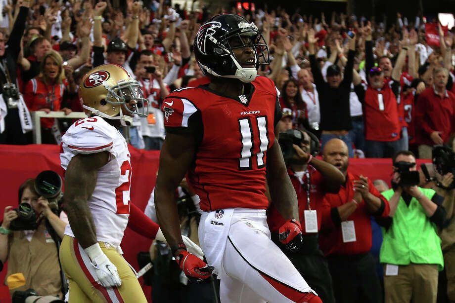 Falcons receiver Julio Jones celebrates his 20-yard touchdown catch against the 49ers in the second quarter. Photo: Chris Graythen / 2013 Getty Images