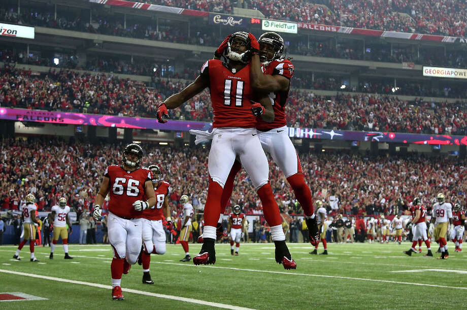 Falcons receiver Julio Jones and Roddy White celebrate a touchdown. Photo: Chris Graythen / 2013 Getty Images