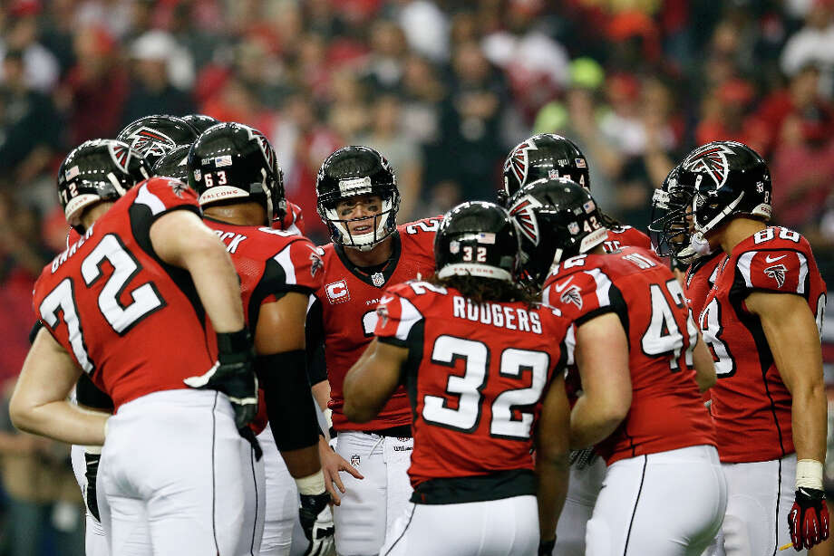 Falcons quarterback Matt Ryan talks to his team in a huddle in the first half. Photo: Kevin C. Cox / 2013 Getty Images