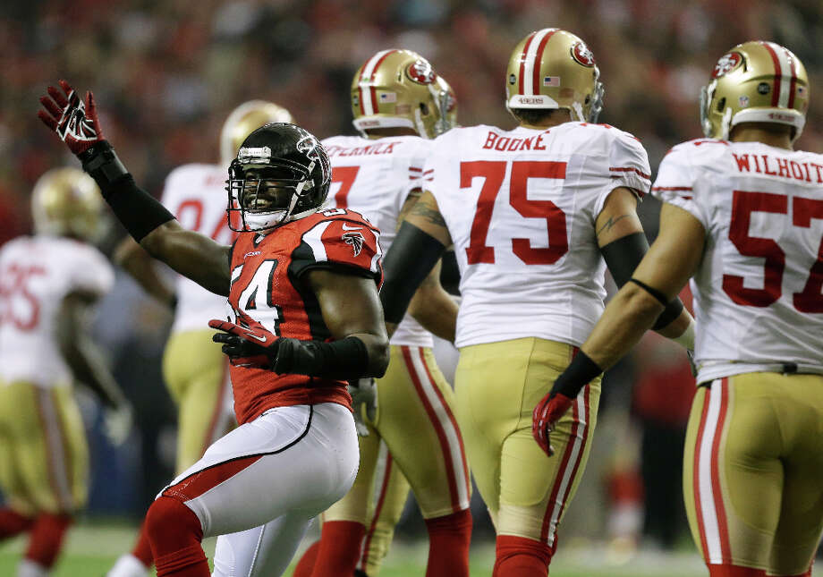 Falcons defender Stephen Nicholas celebrates after recording a sack against the 49ers. Photo: David Goldman