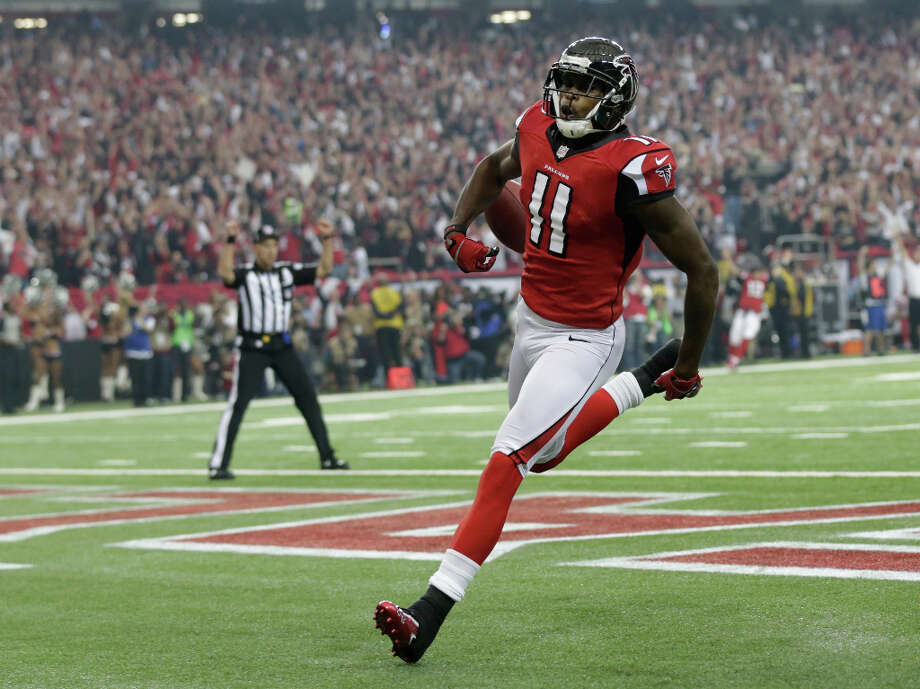 Falcons receiver Julio Jones reaches the end zone after making a 46-yard touchdown catch. Photo: Dave Martin