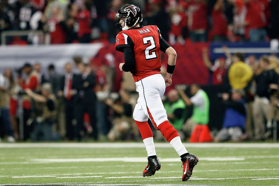 Falcons quarterback Matt Ryan jogs off the field after throwing the first touchdown of the game to Julio Jones. Photo: Kevin C. Cox / 2013 Getty Images