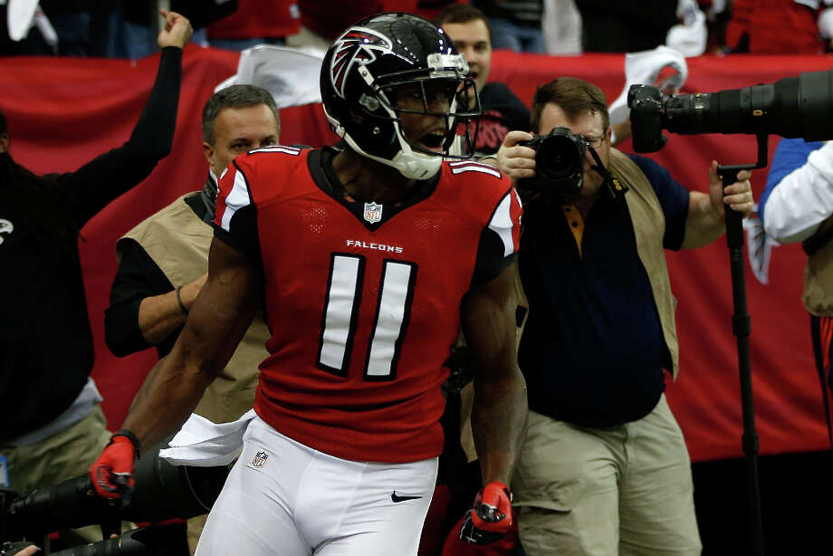 Falcons wide receiver Julio Jones reacts after catching a 46-yard touchdown pass from quarterback Matt Ryan. Photo: Chris Graythen / 2013 Getty Images