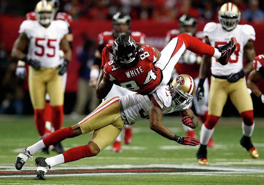 Falcons receiver Roddy White is brought down after bringing in a catch. Photo: Chris Graythen / 2013 Getty Images
