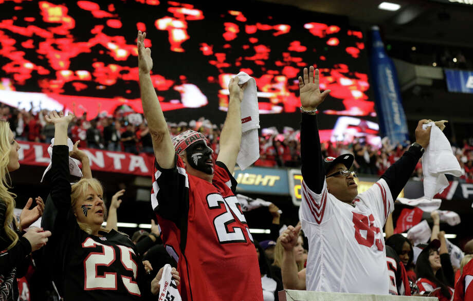 Falcons fans celebrate a touchdown in the first quarter. Photo: Dave Martin