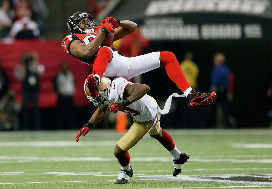 Falcons receiver Roddy White is tackled after grabbing a catch. Photo: Kevin C. Cox / 2013 Getty Images