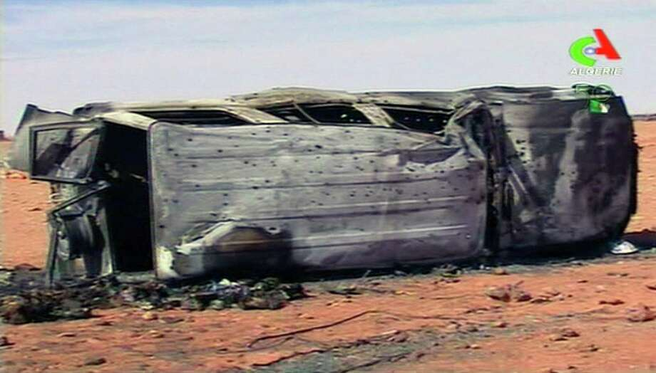 A destroyed vehicle sits on its side in the aftermath of the hostage crisis at the remote Ain Amenas gas facility in Algeria. Photo: Pool Photo, Associated Press / Algerie TV via AP Television
