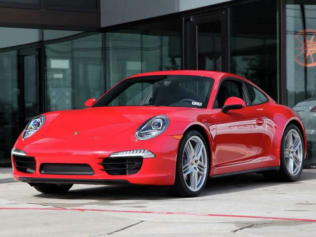 The 2013 Houston Auto Show will feature the 2013 Porsche 991 Carrera 4S. The Chronicle's David Kaplan reports that the auto industry is less focused on promoting hybrids and electric cars 