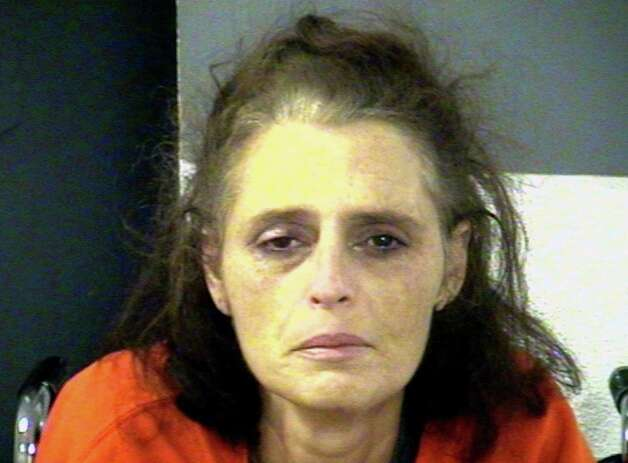 This Jan. 12, 2013 handout photo provided by the Effingham County Sheriff's Office, shows Kimberly Moretz, charged with helping hide the body of Charlie Ray of Savannah, Ga., who police say was killed and dismembered by her husband, Chad Moretz. Police came to Chad Moretz's door to ask questions about a missing person and quickly found themselves in an armed standoff that ended in bloodshed. It was at least the fourth time in 18 months that Effingham County deputies had been dispatched to the house. Neighbors and relatives in southeast Georgia had previously accused Moretz of chasing his wife with a machete, threatening to kill a man with a handgun and of stabbing a dog with a pocket knife after it bit him. None of that could prepare investigators for what they found after the fatal standoff Jan. 11. Photo: AP