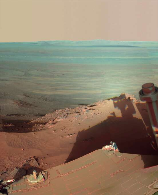 This image provided by NASA shows the late-afternoon shadow cast by the Mars rover Opportunity at Endeavour Crater. The six-wheel rover landed on Mars in January 2004 and is still going strong. Photo: AP