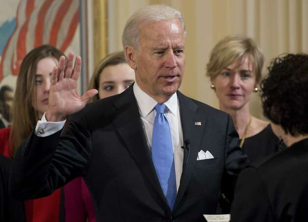 Vice President Joe Biden takes the oath of office during the 57th Presidential Inauguration official swearing-in ceremony at the Naval Observatory on Sunday in Washington. The oath is administered by US Supreme Court Justice Sonia Sotomayor. Photo: AP