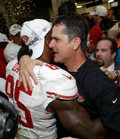 San Francisco 49ers head coach Jim Harbaugh hugs Vernon Davis after the NFL football NFC Championship game against the Atlanta Falcons Sunday, Jan. 20, 2013, in Atlanta. The 49ers won 28-24 to advance to Super Bowl XLVII. (AP Photo/Dave Martin) Photo: Dave Martin, Associated Press
