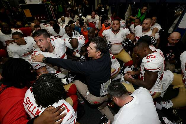 San Francisco 49ers head coach Jim Harbaugh talks to his players after the NFL football NFC Championship game against the Atlanta Falcons Sunday, Jan. 20, 2013, in Atlanta. The 49ers won 28-24 to advance to Super Bowl XLVII. (AP Photo/Dave Martin) Photo: Dave Martin, Associated Press