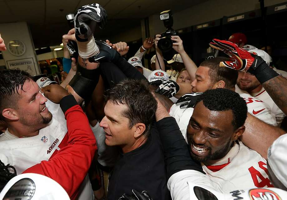The San Francisco 49ers celebrate with head coach Jim Harbaugh, center, after the NFL football NFC Championship game against the Atlanta Falcons Sunday, Jan. 20, 2013, in Atlanta. The 49ers won 28-24 to advance to Super Bowl XLVII. (AP Photo/Dave Martin) Photo: Dave Martin, Associated Press