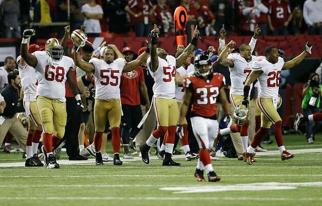 The 49ers bench erupts in joy at the end of the NFC Championship Game. Photo: John Bazemore, Associated Press