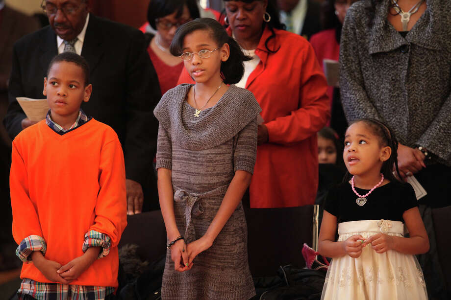 Siblings, from left, Jaden Ford, 8, Assiah Ford, 10, and Trinitee Ford, 4, of Stratford,  attend The Links, Inc. tribute to Rev. Dr Martin Luther, jr.  in Milford, Conn, on Sunday, January 20, 2013. Photo: BK Angeletti, B.K. Angeletti / Connecticut Post freelance B.K. Angeletti