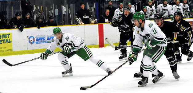Danbury Whalers Alec Kirschner, left, and Phil Aucoin, right, move in to score the first Whalers goal against the Danville Dashers Sunday, Jan. 20, 2013 in Danbury. Photo: Michael Duffy