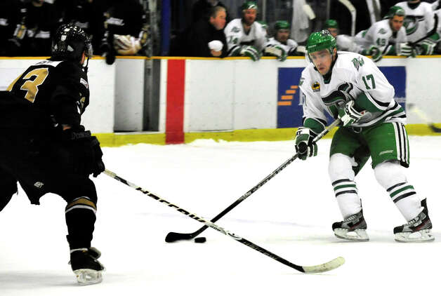 Danbury Whalers Alec Kirschner, right, moves in to score the first Whalers goal against Ryan Huggett of the Danville Dashers Sunday, Jan. 20, 2013 in Danbury. Photo: Michael Duffy