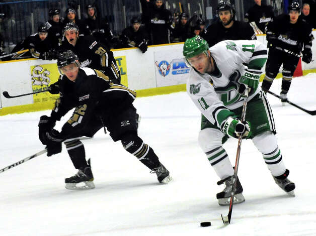 Danbury Whalers Phil Aucoin, right, moves against the Danville Dashers Sunday, Jan. 20, 2013 in Danbury. Photo: Michael Duffy