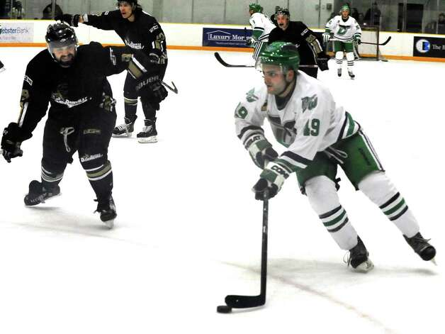Danbury Whalers Adam Houli moves against Justin Levac, left, of the Danville Dashers Sunday, Jan. 20, 2013 in Danbury. Photo: Michael Duffy