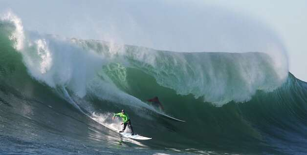 Shawn Dollar (left), who finished sixth, and fifth-place finisher Mark Healey share a wave during the finals portion of the Mavericks surfing competition. Photo: Mathew Sumner, Special To The Chronicle