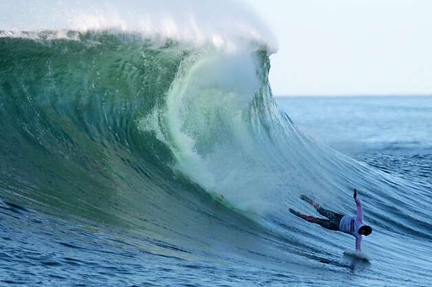 Peter Mel wipes out during the finals, but the 43-year-old Santa Cruz surfer went on to finally add Mavericks to his portfolio of surfing victories. Photo: Mathew Sumner, Special To The Chronicle