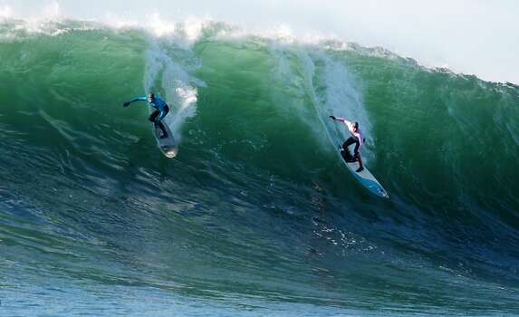 Greg Long, left, and Peter Mel drop into a wave during the finals of the Mavericks Invitational on Sunday, January 20, 2013. Photo: Mathew Sumner, Special To The Chronicle